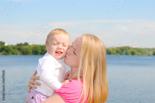 mother kissing her child