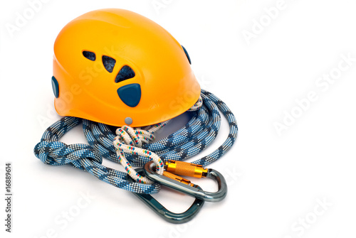 climbing equipment - carabiners, helmet and blue rope - 16889614