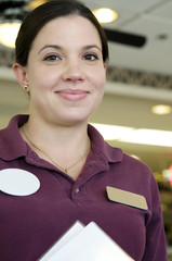 Friendly smiling service host woman with name tag