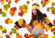 Beautiful girl wearing hat and gloves and maple leaves