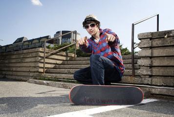 Skateboarder pointing at camera