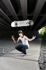 Skateboarder flipping board in the air