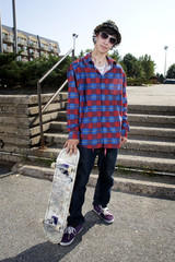 Young skateboarder standing up