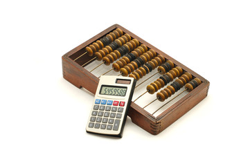 Abacus and calculator on white background