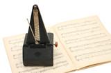 metronome on sheet music background