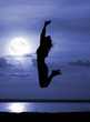 Silhouette jumping women on moon night