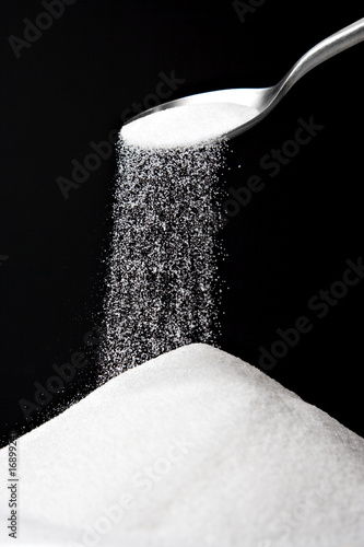 Sugar Spilling from Spoon