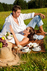 Happy smiling couple having picnic