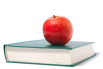 red apple and green book
