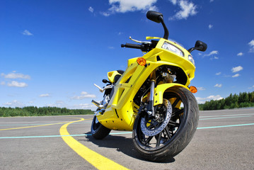 Motorcycle standing on the road