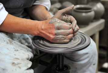 Artisan making a pot