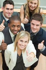 High view of happy business team with thumbs up