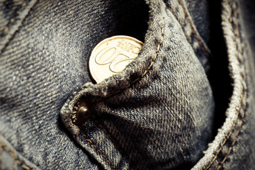 Jeans pockets with twenty cents coins
