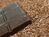 Chocolate bars on chocolate granules background poster