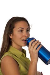 Woman drinking in blue bottle of water