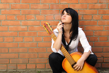 woman with a cigarette and a guitar