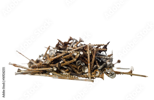 Pile of rusty nails isolated on white background
