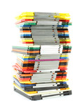 Uneven stack of old computer floppy disks poster