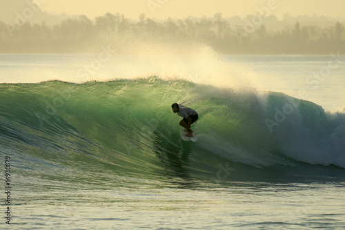 Backlit surfer in barrel, Mentawai Islands, Indonesia
