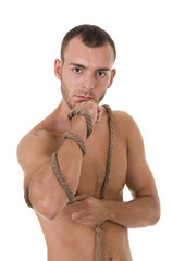 Young man with rope studio shoot