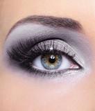 Make-up of woman eye with grey eyeshadows poster