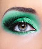 Female eye with a green eyeshadows poster