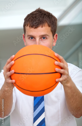 Business man with a basketball