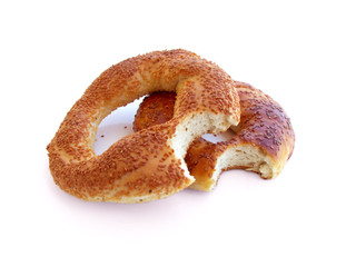 Bitten Turkish bagels with sesame isolated on white