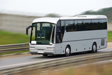 Fototapety Fast moving tourist bus. Clipping path inside.