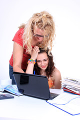 Woman helping young girl