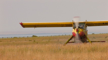 HD plane with propeller stands in the middle of the field