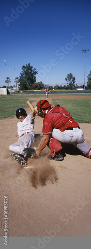 Baseball player sliding into base