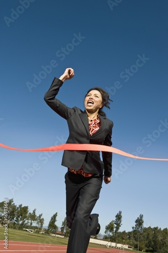Businesswoman Crossing the Winning Line