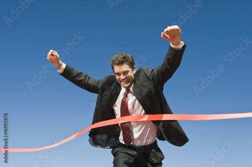 Businessman Crossing the Winning Line