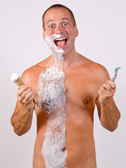 unshaved man with foam