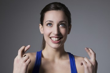 Brunette with finges crossed
