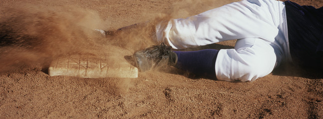 Baseball player lying in dirt, low section