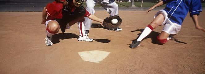 Girls 13-17 playing baseball, low section