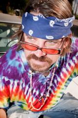 Hippie on a car Hood