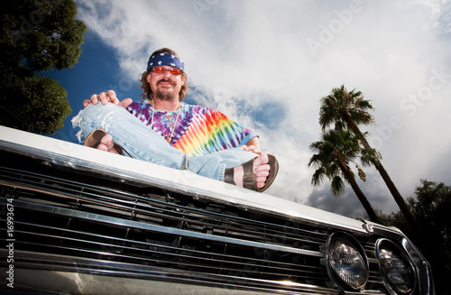 Hippie on a car Hood