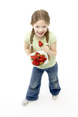 Studio Portrait of Smiling Girl Holding Bowl of Strawberries