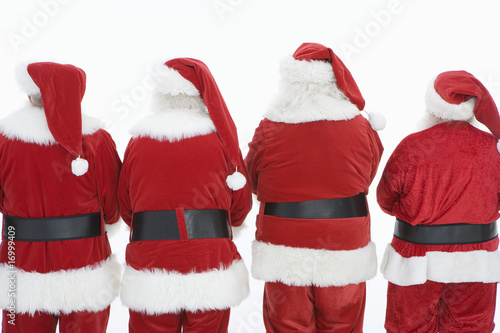 Group of men dressed as Santa Claus, rear view