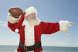 Father Christmas prepares to throw a rugby ball