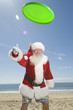 Father Christmas throws a green fisbee