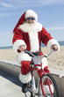Father Christmas cycles along promenade