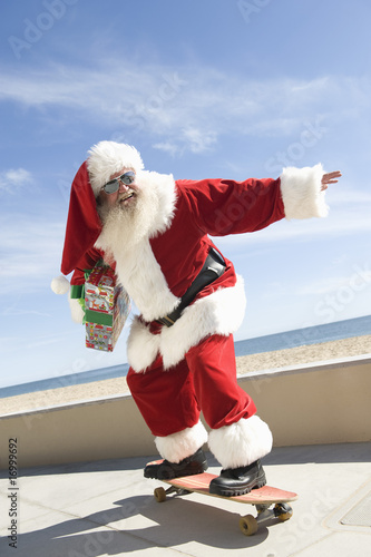 Father Christmas skateboards