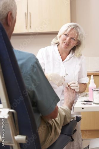 Chirpodist treating client in clinic
