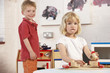 Two Young Children Playing Together at Montessori/Pre-School