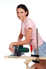 girl with portable circular saw