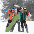 Healthy lifestyle image of happy snowboarders team, .Snowfall